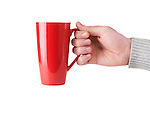 Person holding red tall tea mug in his hand isolated on white background