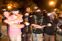 CHARLOTTE, NC - September 3, 2012 - Many of the marchers were dressed in black and locked arms as they marched down the street.