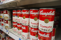 Cans of Campbell's Tomato Soup are seen in a supermarket in New York on Saturday, February 18, 2012. The Campbell Soup Co. recently announced that its second-quarter net income fell 14 percent citing an increase in commodity costs. (© Richard B. Levine)