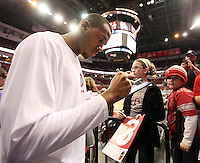 Ohio State's Trey McDonald (55) sign autographs for fans before a game against against North Florida, Friday, Nov. 29, 2013, in Columbus, Ohio. (Photo by Terry Gilliam)
