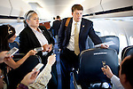 Gov. Mitt Romney's traveling press secretary Rick Gorka repeats Romney's statement regarding the Supreme Court's ruling on Arizona's immigration law as reporters press him for a more specific statement on the campaign plane in Phoenix, Arizona, June 25, 2012.