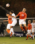 1 November 2006: Clemson's Parker Rogers (left) and Mark Buchholz (13) defend Virginia's Ian Holder (center). Virginia defeated Clemson 2-0 at the Maryland Soccerplex in Germantown, Maryland in an Atlantic Coast Conference college soccer tournament quarterfinal game.