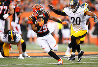 Giovani Bernard #25 of the Cincinnati Bengals carries the ball past Will Allen #20 of the Pittsburgh Steelers during the game at Paul Brown Stadium on December 12, 2015 in Cincinnati, Ohio. (Photo by Jared Wickerham/DKPittsburghSports)