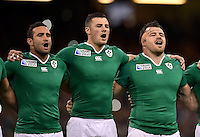 Dave Kearney, Robbie Henshaw, Cian Healy of Ireland sing their national anthem. Rugby World Cup Pool D match between France and Ireland on October 11, 2015 at the Millennium Stadium in Cardiff, Wales. Photo by: Patrick Khachfe / Onside Images
