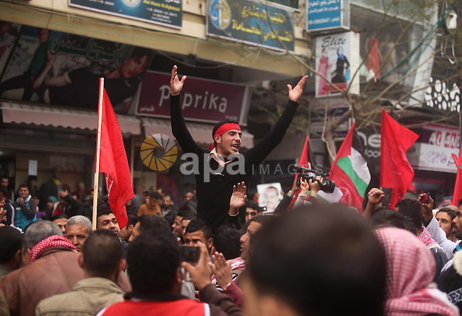 Palestinian supporters of the Popular Front for the Liberation of Palestine (PFLP) gather during a rally marking the 7th anniversary of the death of the front founder George Habash, in Gaza city on January 26, 2015. Photo by Ashraf Amra