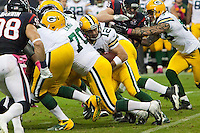 Reigning NFL MVP Aaron Rodgers keeps the ball on a quarterback sneak as the visiting Green Bay Packers defeated the Houston Texans 42-24 at Reliant Stadium, Oct. 14, 2012