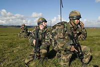 Members of the French Foreign Legion take orders over the radio after jumping over the airport of Tarbes, France, during a full scale multi-force exercise, 11 December 2007.