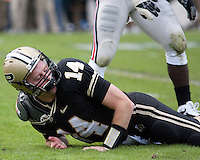 Purdue quarterback Joey Elliott looks downfield after taking a hard hit. The Purdue Boilermakers defeated the Ohio State Buckeyes 26-18 at Ross-Ade Stadium, West Lafayette, Indiana on October 17, 2009..