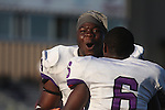 Ayo Idowu and Aaron Terrell-Byrd (6) celebrate the Tommies come-from-behind victory over Wisc.-Eau Claire in week 1.