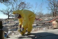 A memeber of a Central American clean up team gets dressed in protective gear before entering a flooded home in  Biloxi afetr Hurricane Katrina.
