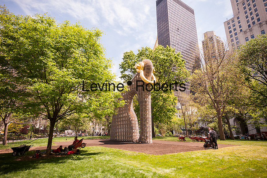 """Workers take a break from the installation of """"Big Bling"""" by the artist Martin Puryear in Madison Square Park in New York on Wednesday, May 11, 2016. The forty-foot high installation by Martin Puryear, an American sculptor, is the largest he has ever created and was commissioned by the Madison Square Park Conservancy. It officially opens to the public May 16 and will be on display until January 8, 2017.  (© Richard B. Levine)"""