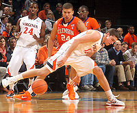 Feb. 2, 2011; Charlottesville, VA, USA; Virginia Cavaliers guard Joe Harris (12) looses control of the ball in front of Clemson Tigers forward Milton Jennings (24) during the game at the John Paul Jones Arena. Mandatory Credit: Andrew Shurtleff