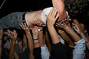 Festie, crowd surfing. 2006...Image from the book project Welcome Home: Building the Michigan Womyn's Music Festival, self-published First-Edition 2009...Photo by Angela Jimenez.copyright 2009 Angela Jimenez Photography