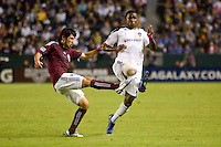 Kosuke Kimura defender of the Colorado Rapids clears a ball in front of advancing LA Galaxy forward Edson Buddle. The Colorado Rapids defeated the LA Galaxy 3-2 at Home Depot Center stadium in Carson, California on Saturday October 16, 2010.