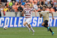 Houston, TX - Friday December 11, 2016: Tanner Beason (3) of the Stanford Cardinal and Jacori Hayes (8) of the Wake Forest Demon Deacons race for a loose ball at the NCAA Men's Soccer Finals at BBVA Compass Stadium in Houston Texas.