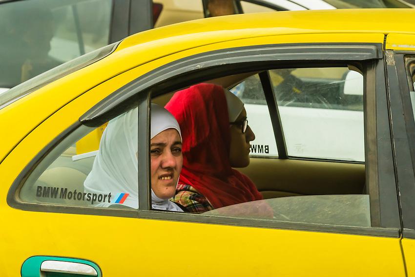 Jordanian women in a taxicab, Amman, Jordan.