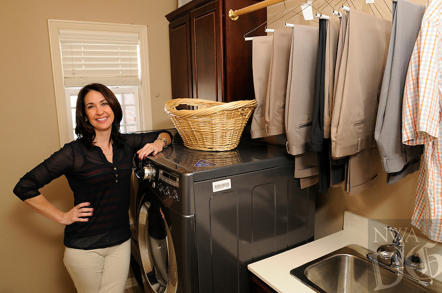 NWA Democrat-Gazette/ J.T. WAMPLER -- Brandi McKinney of Rogers in her laundry room March 25, 2015.