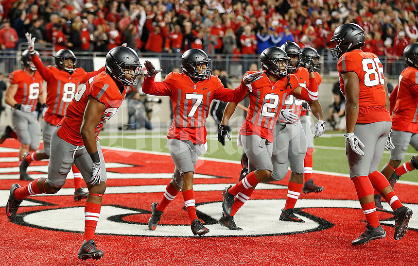 Ohio State Buckeyes cornerback Damon Webb (7) celebrates his interception for a touchdown during first quarter of the NCAA football game between the Ohio State Buckeyes and the Nebraska Cornhuskers at Ohio Stadium in Columbus on Saturday, November 5, 2016. (Columbus Dispatch photo by Jonathan Quilter)