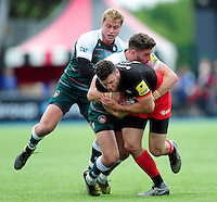 Duncan Taylor of Saracens is tackled by Owen Williams of Leicester Tigers. Aviva Premiership semi final, between Saracens and Leicester Tigers on May 21, 2016 at Allianz Park in London, England. Photo by: Patrick Khachfe / JMP