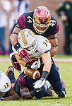 Florida State defensive end DeMarcus Walker strips the ball from Chattanooga running back Derrick Craine in the second half of an NCAA college football game in Tallahassee, Fla., Saturday, Nov. 21, 2015.  Florida State defeated Chattanooga 52-13.  (AP Photo/Mark Wallheiser)