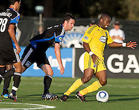 Emilio Renteria of the Crew controls the ball away from Bobby Burling of the Earthquakes during the first half of the game at Buck Shaw Stadium in Santa Clara, California.  San Jose Earthquakes tied Columbus Crew, 2-2.