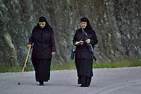 Kalambaka, Kastraki, Meteora, Greece, June 2006. Two nuns of the Agios Stephanos Nunnery read from the bible on a morning stroll. The Monastaries of Meteora can be found high on the steepest rocks. Photo by Frits Meyst/Adventure4ever.com