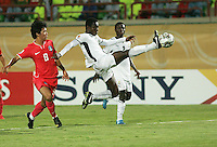 Ghana's Daniel Addo (5) makes a goal attempt against South Korea's Young Duk Seo (8) stands on the field before the match against South Korea during the FIFA Under 20 World Cup Quarter-final match between Ghana and South Korea at the Mubarak Stadium  in Suez, Egypt, on October 09, 2009.