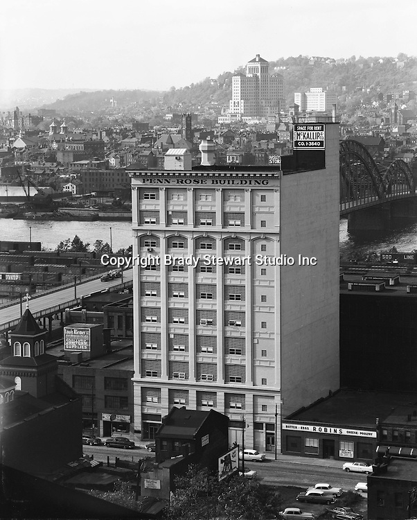 Pittsburgh PA:  View of the Penn Rose Building with Allegheny General Hospital in the background - 1954. Building was located in the Strip District of Pittsburgh