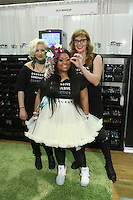 Obsessive Compulsive Cosmetics staff at the Makeup Show NYC, in the Metropolitan Pavilion, May 15 2011.