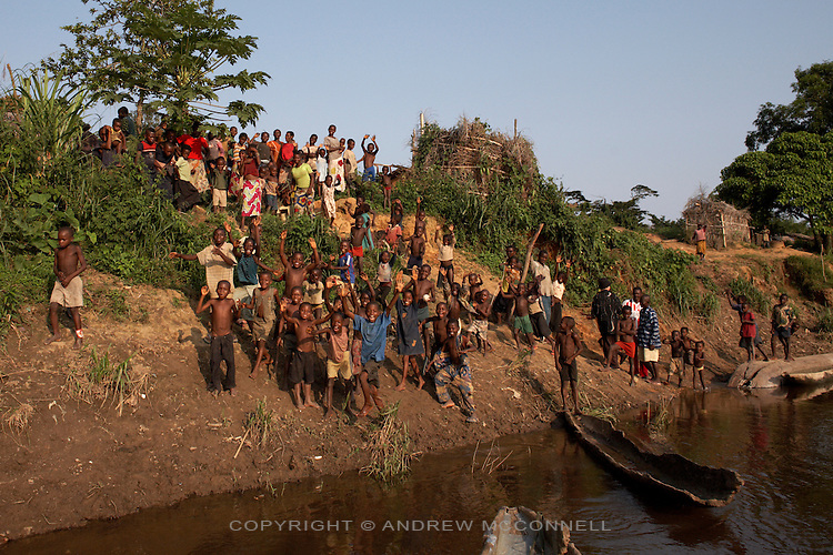 Local people bid farewell to the NG Adeventure team in the village of Lokombe Lokombe by the banks of the Congo river, DR Congo, on Friday, Dec. 5, 2008. The communities here live much as they have done for centuries, with no electricity and little access to the outside world.