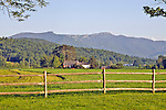 View of Mount Mansfield and adjacent peaks at dawn from a field in Stowe, Vermont