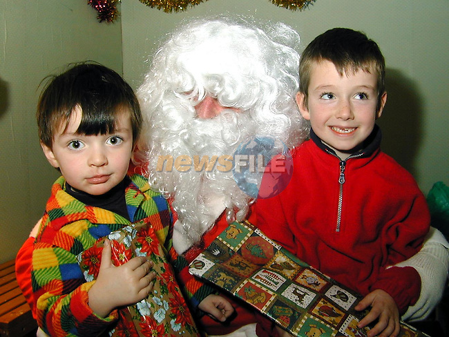 Nicholas and Owen Collins from Five Oaks with Santa at the christmas fair in Julianstown..Picture Paul Mohan Newsfile