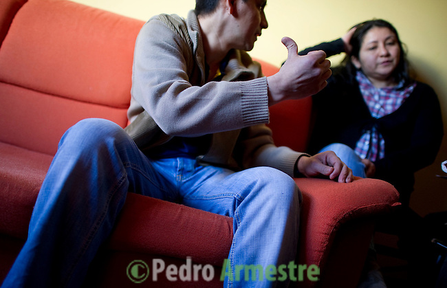 Ecuadorian homeowners Nelson Castillo (L) and his wife Kelly Herrera (R) sit on March 13, 2012 in their house in Madrid before their eviction. Spain on March 9 approved a new voluntary 'code of conduct' for banks which aims to help poor homeowners settle their debts and reduce a wave of evictions brought on by the economic crisis. Spanish banks currently seize the homes of those who default on their mortgages and often demand further payment from those evicted if the value of the house has fallen below that of the loan. The new rules will apply in cases where every member of a household is unemployed and mortgage payments are equal to more than 60 percent of their income. (c) Pedro ARMESTRE