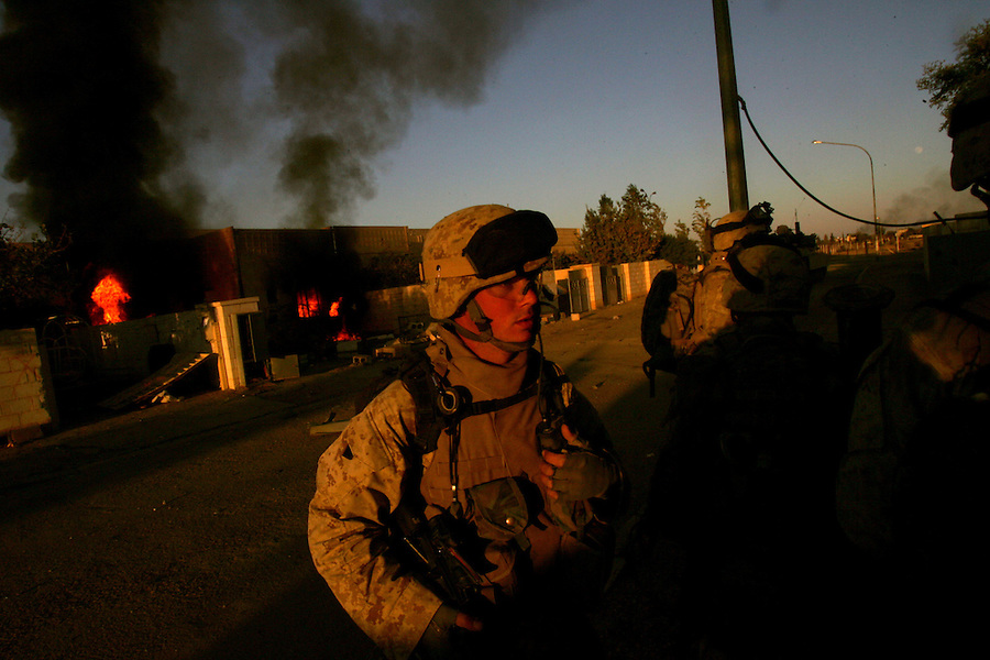 Smoke rises from a burning home as Marines from Golf Co. 2nd Battalion 1st Marines carry on with Operation Steel Curtain in Ubaydi, Iraq on Tues. Nov. 14, 2005.