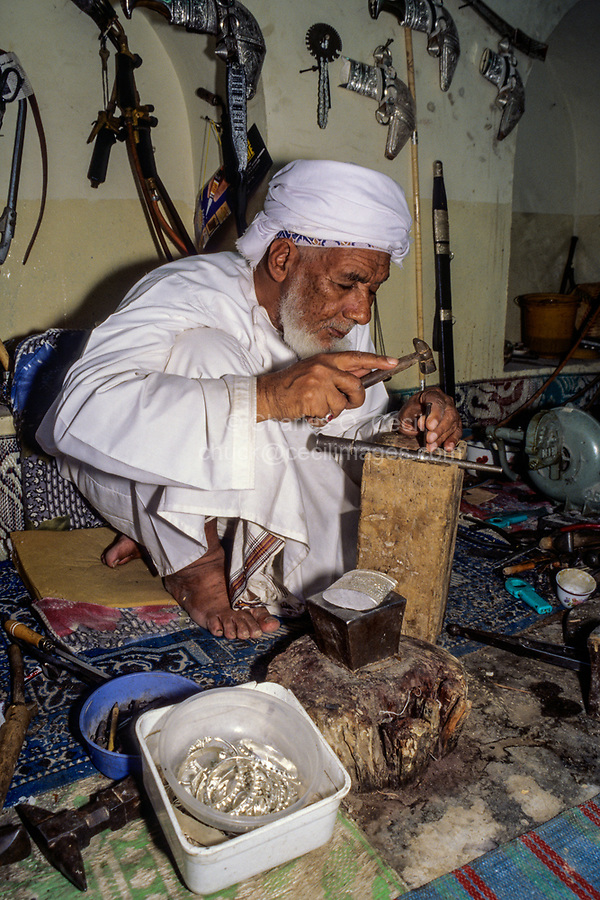Rustaq, Oman.  Rashid al-Obeidani, Silversmith, in his Workshop, Making a Silver Ring.