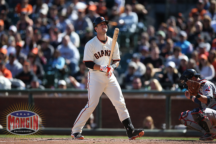 SAN FRANCISCO, CA - APRIL 26:  Buster Posey #28 of the San Francisco Giants reacts after being hit by a pitch against the Cleveland Indians during the game at AT&T Park on Saturday, April 26, 2014 in San Francisco, California. Photo by Brad Mangin