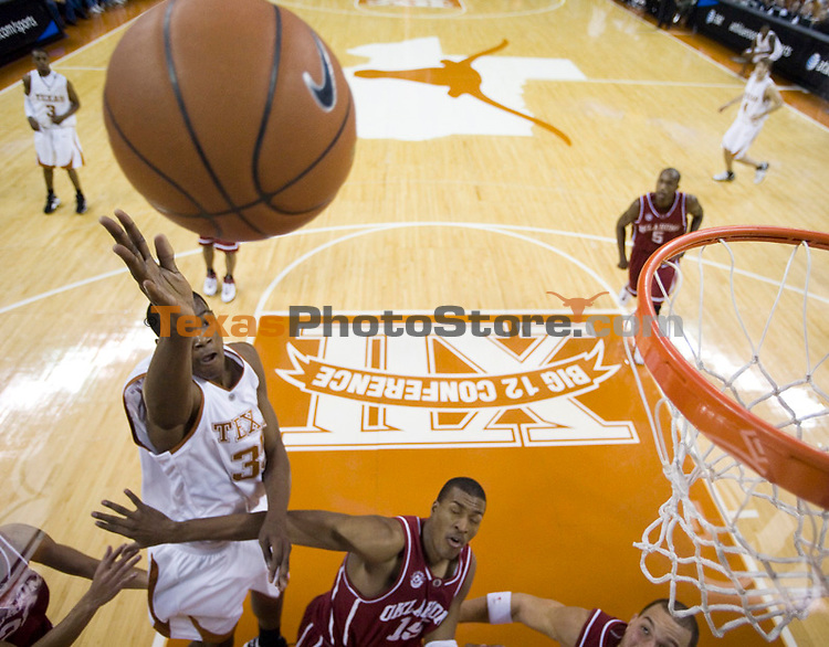Texas forward Kevin Durant, left, shoots over Oklahoma defender David Godbold during first half action in their men's college basktball game Saturday January 13, 2007 in Austin, Texas.  Durant lead all scorers with 20 points as the Longhorns beat Oklahoma 80-69. (AP Photo/Jim Sigmon University of Texas Sports Information)