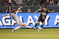 LA Galaxy midfielder Chris Birchall (8) moves to advancing Sebastien Le Toux (9) Philadelphia Union. The LA Galaxy defeated the Philadelphia Union 1-0 at Home Depot Center stadium in Carson, California on  April  2, 2011....