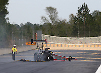 Mar 13, 2015; Gainesville, FL, USA; Members of the Safety Safari guides NHRA top fuel driver Shawn Reed off the track during qualifying for the Gatornationals at Auto Plus Raceway at Gainesville. Mandatory Credit: Mark J. Rebilas-