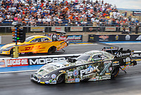 Jul 24, 2016; Morrison, CO, USA; NHRA funny car driver John Force (near) races alongside Del Worsham during the Mile High Nationals at Bandimere Speedway. Mandatory Credit: Mark J. Rebilas-USA TODAY Sports