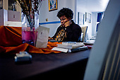 Philadelphia, Pennsylvania<br /> May 5, 2010<br /> <br /> 99er Rita Calicut at home doing a job search on her computer. She is a professional fund raiser who previously worked with Multiple Sclerosis Foundation and in higher education. She has a 14 year old son Kory Calicat-Wayns, who will have to attend public school in Philadelphia next year unless she finds employment.