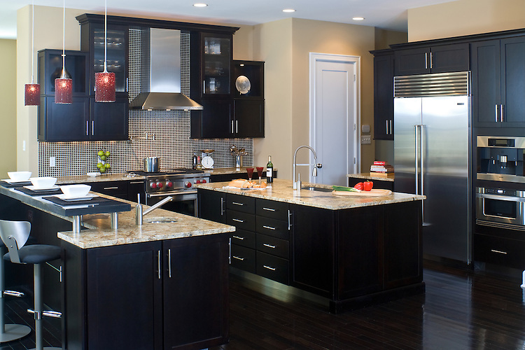 contemporary kitchen featuring cherry cabinets with a dark coffee
