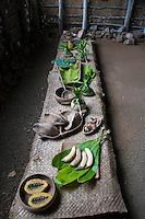 Examples of food on a lauhala mat-covered table in a recreated Hawaiian hut (used as a men's eating house), Kamokila Hawaiian Village, Wailua River Valley, Kauai.