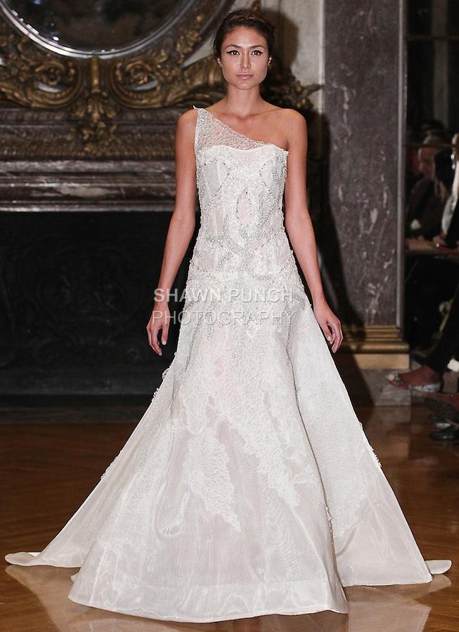Model walks runway in a bridal gown from the Karen Sabag 2015 Bridal Collection, at Burden Mansion during New York Bridal Fashion Week Spring 2015.
