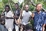 Members of the Arrow Boys, a self-defense militia, in the village of Riimenze, in Southern Sudan's Western Equatoria State. The men patrol the forest around the village, especially at night, on the look out for the Lord's Resistance Army, which has displaced tens of thousands in recent months along the border area. Many believe the northern Sudan government is behind the attacks in its desire to destabilize the south in the period leading to a January 2011 referendum on secession. NOTE: In July 2011 Southern Sudan became the independent country of South Sudan.