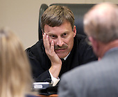 Prince William County (Virginia) Circuit Court Judge LeRoy Millette, Jr., listens to Prosecutor Paul Ebert during the trial of sniper suspect John Allen Muhammad in courtroom 10 at the Virginia Beach Circuit Court in Virginia Beach, Virginia on October 29, 2003. <br /> Credit: Dave Ellis - Pool via CNP