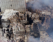 Ground Zero, New York City, NY - Sept. 17, 2001 -- An aerial view shows only a small portion of the crime scene where the World Trade Center collapsed following the September 11, 2001 terrorist attack on September 17, 2001.  Surrounding buildings were heavily damaged by the debris and massive force of the falling twin towers.  Clean-up efforts are expected to continue for months.  .Credit: Eric J. Tilford - US Navy / CNP