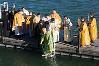 Greek catholic priest puts a cross into the water as he sanctifies the water of river Danube on the occasion of Epiphany in central Budapest, Hungary on January 06, 2017. ATTILA VOLGYI