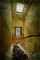 Staircase in an abandoned asylum, with windows