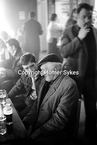Men having a lunch time drink Glasglow Pub Scotland 1979